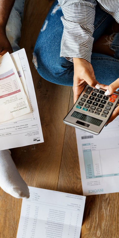 couple figuring out how to get out of debt quickly